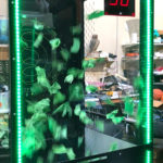 Custom branded money cash blowing machine for NIKE promotional event in San Francisco Union Square store
