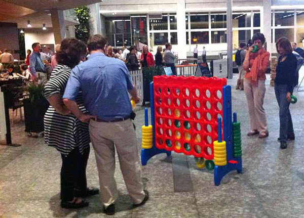 Giant Connect 4 - playing the game in a shopping center.