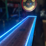Large Glowing shuffle board table game rental