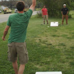 Playing Been Bag Toss Game Rental Event