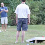 Teams are competing during rented corn hole game