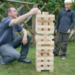 Giant jenga tumble tower game for rent is a family game San Francisco from Video Amusement