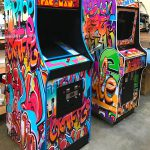 Classic arcade games customized with graffiti art.