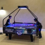 Quad Air 4 player air hockey table game with boys playing