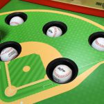 Whac a Ball playfield detail with official baseballs.