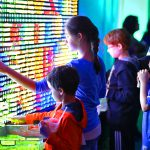 Children playing Giant Light Bright game.