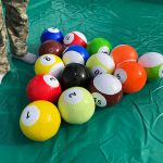 Colorful soccer balls with billiard ball numbers
