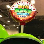 Big Bass Wheel with a top sign