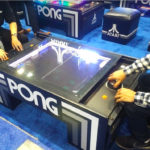 Classic Pong Arcade game from Atari on display at a convention
