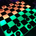 Giant LED Checker Table Game for rent is attractive colorful game available from Video Amusement