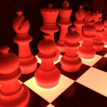 Giant LED Glow Chess Table rental with red reflection. Available for rent from Video Amusement.