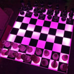 LED glow light on this chess table rental will light up the room. Available in Bay Area from Video Amusement.