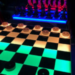 Large LED glowing checker and chess table game for rent from Video Amusement.