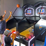Father and son playing NBA Game Time Commercial Rental Arcade Basketball Game