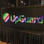 Giant Bright Lights with custom corporate branding logo during rental event
