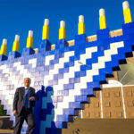 Giant Menorah made with giant lego blocks.