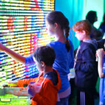 Kids are playing with Giant Bright Lite rental game with Video Amusement