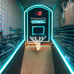 NBA Hoops game with corporate branding and lights for event in Los Angeles.