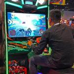 ATV Slam Dirt Racing Simulator Arcade Game at a trade show in Las Vegas.
