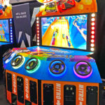 Hot Wheels 6 player King of the Road racing arcade game rental at Las Vegas trade show.