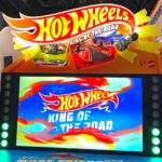 Hot Wheels 6 player interactive driving arcade game at the tradeshow in Las Vegas from Video Amusement rental.