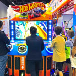 Hot Wheels 6 player driving arcade game at the tradeshow rental in San Francisco.