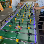 Setting up16-player foosball table setup for rental San Francisco California