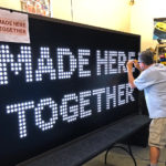 Corporate slogan Made here together on rented Illumination Station Game